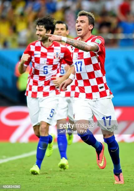 Mario Mandzukic of Croatia celebrates scoring his team's third goal during the 2014 FIFA World Cup Brazil Group A match between Cameroon and Croatia...