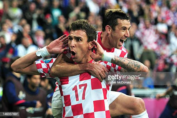 Mario Mandzukic of Croatia celebrates scoring their first goal with Darijo Srna of Croatia during the UEFA EURO 2012 group C match between Italy and...