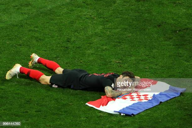 Mario Mandzukic of Croatia celebrates victory following the 2018 FIFA World Cup Russia Semi Final match between England and Croatia at Luzhniki...