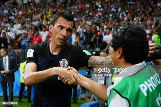 Mario Mandzukic of Croatia celebrates with a photographer after scoring his team's second goal during the 2018 FIFA World Cup Russia Semi Final match...
