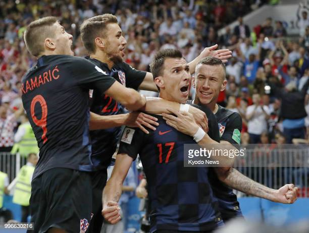 Mario Mandzukic of Croatia celebrates with his teammates after scoring his side's second goal against England during the second half of extra time at...