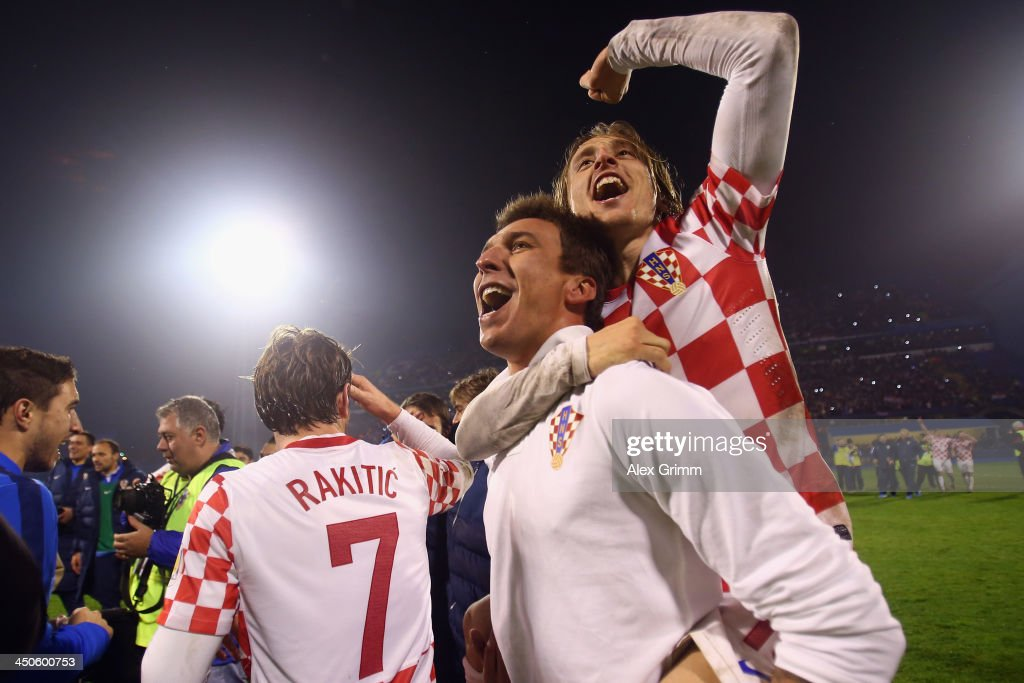 Mario Mandzukic of Croatia celebrates with team mate Luka Modric (top) after the FIFA 2014 World Cup Qualifier play-off second leg match between Croatia and Iceland at Maksimir Stadium on November 19, 2013 in Zagreb, Croatia.