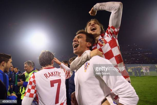 Mario Mandzukic of Croatia celebrates with team mate Luka Modric after the FIFA 2014 World Cup Qualifier playoff second leg match between Croatia and...