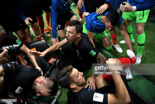 Mario Mandzukic of Croatia celebrates with team mates after scoring his team's second goal during the 2018 FIFA World Cup Russia Semi Final match...