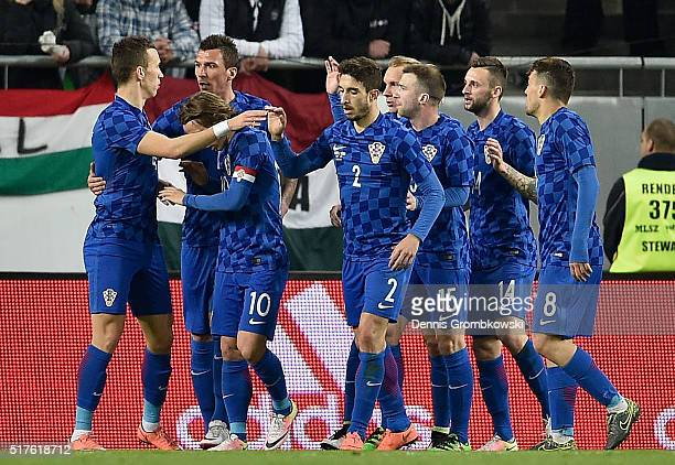 Mario Mandzukic of Croatia celebrates with team mates as he scores the opening goal during the International Friendly match between Hungary and...
