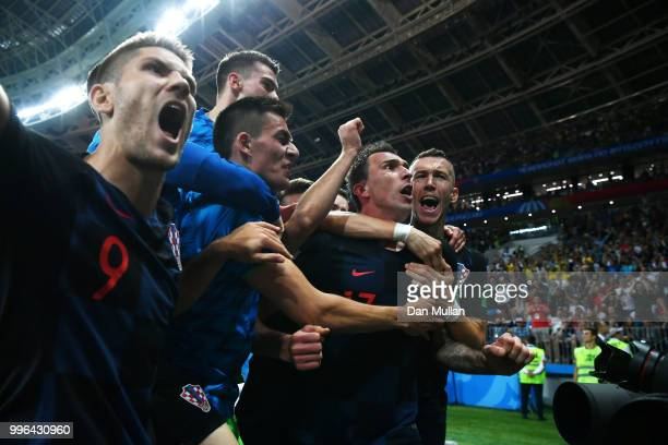Mario Mandzukic of Croatia celebrates with teammates after scoring his team's second goal during the 2018 FIFA World Cup Russia Semi Final match...