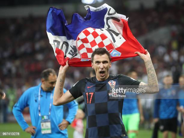 Mario Mandzukic of Croatia commemorates victory at the end of the 2018 FIFA World Cup Russia Semi Final match between England and Croatia at Luzhniki...