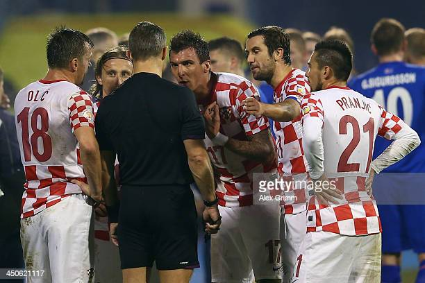 Mario Mandzukic of Croatia discusses with referee Bjoern Kuipers after seeing a red card during the FIFA 2014 World Cup Qualifier playoff second leg...