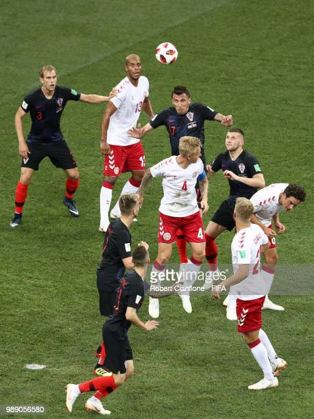 Mario Mandzukic of Croatia heads the ball over Simon Kjaer of Denmark during the 2018 FIFA World Cup Russia Round of 16 match between Croatia and...