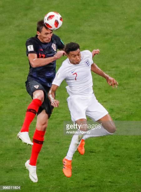Mario Mandzukic of Croatia in action against Jesse Lingard of England during the 2018 FIFA World Cup Russia Semi Final match between England and...
