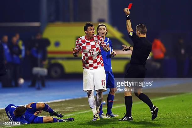 Mario Mandzukic of Croatia is sent off by referee Bjoern Kuipers during the FIFA 2014 World Cup Qualifier playoff second leg match between Croatia...