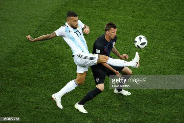 Mario Mandzukic of Croatia is tackled by Nicolas Otamendi of Argentina during the 2018 FIFA World Cup Russia group D match between Argentina and...