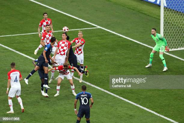 Mario Mandzukic of Croatia scores an own goal from Antoine Griezmann of France's freekick France's first goal during the 2018 FIFA World Cup Final...