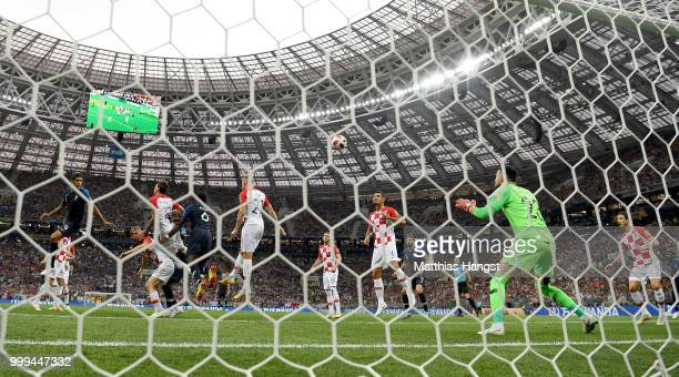 Mario Mandzukic of Croatia scores an own goal from Antoine Griezmann of France's free-kick for France's first goal during the 2018 FIFA World Cup...