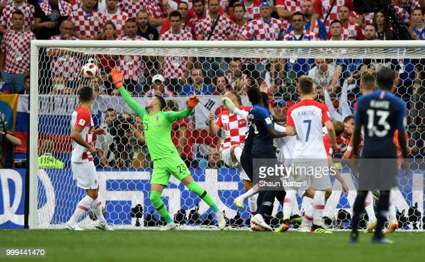 Mario Mandzukic of Croatia scores an own goal past team mate Danijel Subasic France's first goal during the 2018 FIFA World Cup Final between France...