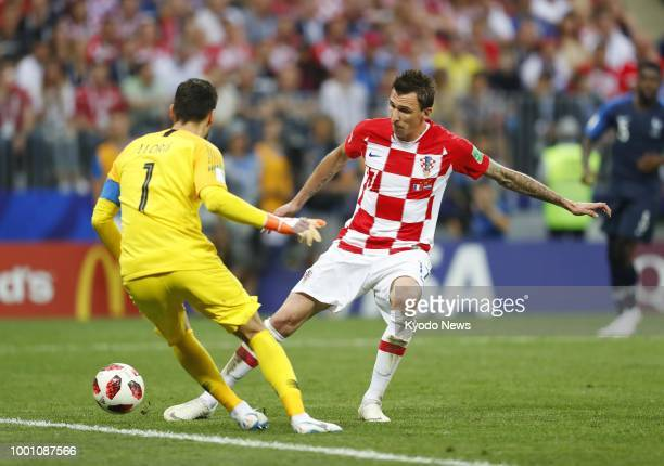 Mario Mandzukic of Croatia scores his side's second goal past France goalkeeper Hugo Lloris during the second half of the World Cup final at Luzhniki...