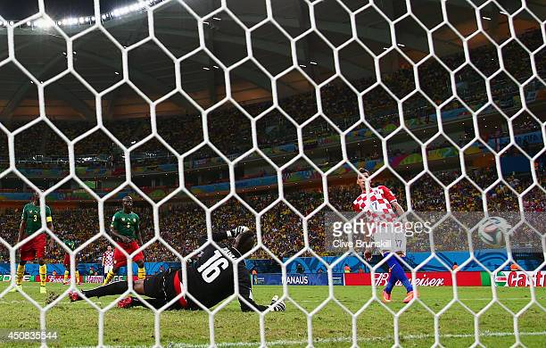 Mario Mandzukic of Croatia scores his team's fourth goal, his second, past Charles Itandje of Cameroon during the 2014 FIFA World Cup Brazil Group A...