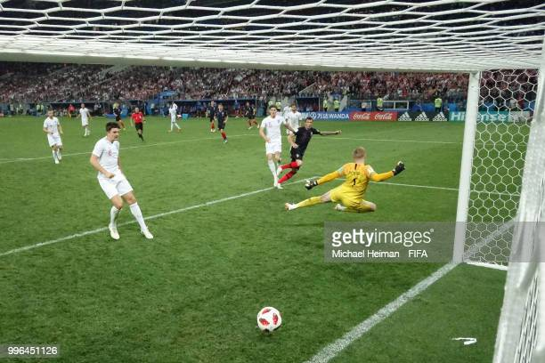 Mario Mandzukic of Croatia scores his team's second goal past Jordan Pickford of England during the 2018 FIFA World Cup Russia Semi Final match...