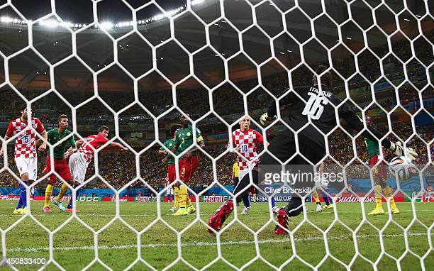 Mario Mandzukic of Croatia scores his team's third goal on a header past Charles Itandje of Cameroon during the 2014 FIFA World Cup Brazil Group A...