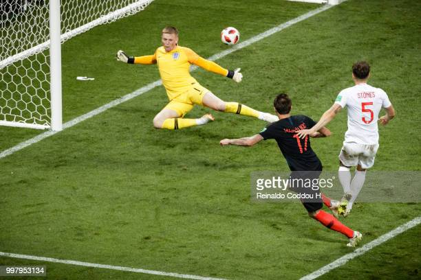 Mario Mandzukic of Croatia scores in extra time to make it 21 during the 2018 FIFA World Cup Russia Semi Final match between England and Croatia at...