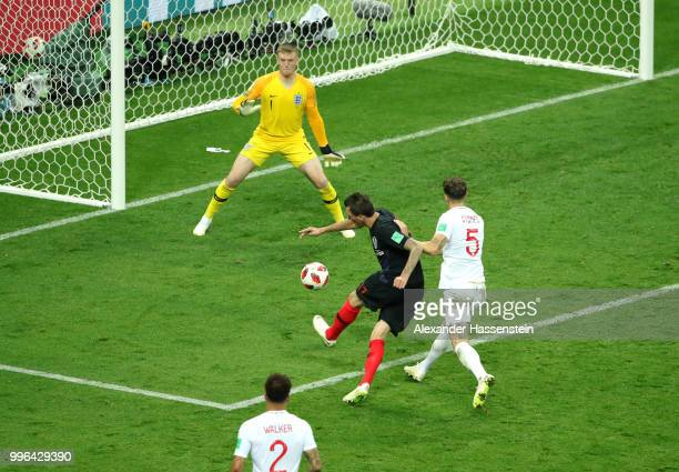 Mario Mandzukic of Croatia scores past Jordan Pickford of England his team's second goal during the 2018 FIFA World Cup Russia Semi Final match...
