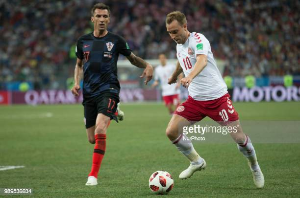 Mario Mandzukic of Croatia vies Christian Eriksen of Denmark during the 2018 FIFA World Cup Russia Round of 16 match between Croatia and Denmark at...