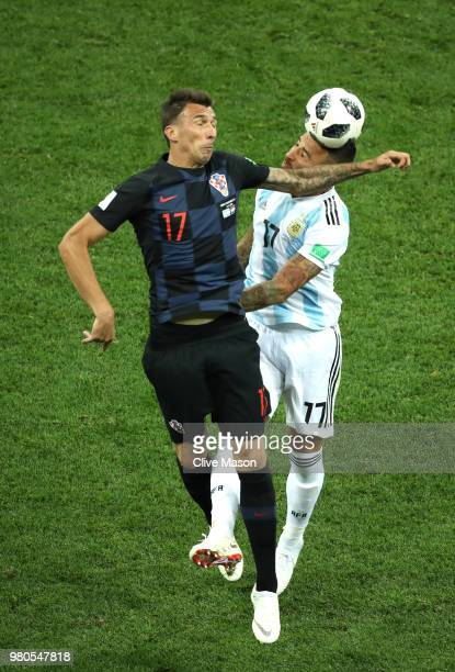 Mario Mandzukic of Croatia wins a header over Nicolas Otamendi of Argentina during the 2018 FIFA World Cup Russia group D match between Argentina and...