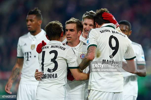 Mario Mandzukic of FC Bayern Muenchen celebrates with teammates after heading his team's fourth goal during the Bundesliga match between Hannover 96...