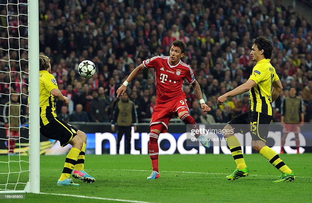 Mario Mandzukic of FC Bayern Muenchen scores his side's first goal during the UEFA Champions League final match between Borussia Dortmund and FC Bayern Muenchen at Wembley Stadium on May 25, 2013 in London, England.