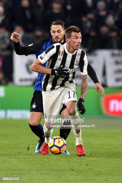Mario Mandzukic of Juventus and Danilo D'Ambrosio of FC Internazionale compete for the ball during the Serie A match between Juventus and FC...