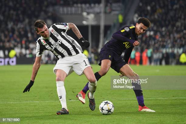 Mario Mandzukic of Juventus battles Dele Alli of Tottenham during the UEFA Champions League Round of 16 First Leg match between Juventus and...