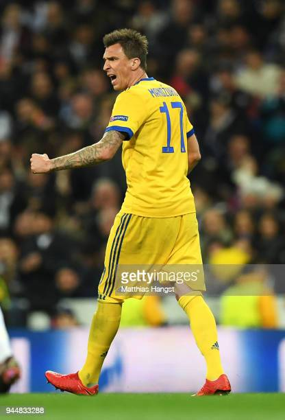 Mario Mandzukic of Juventus celebrates after scoring his sides second goal during the UEFA Champions League Quarter Final Second Leg match between...