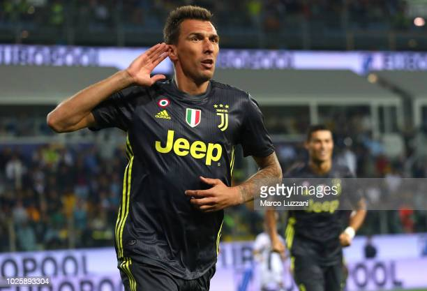 Mario Mandzukic of Juventus celebrates after scoring the opening goal during the serie A match between Parma Calcio and Juventus at Stadio Ennio...