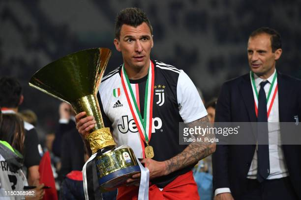 Mario Mandzukic of Juventus celebrates during the awards ceremony after winning the Serie A Championship during the Serie A match between Juventus...