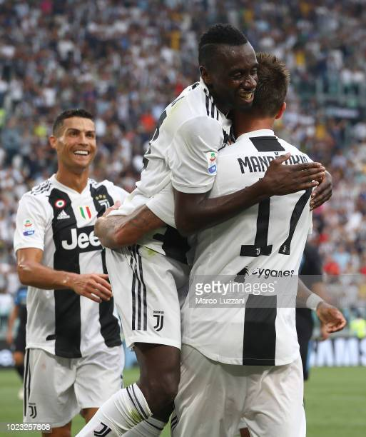 Mario Mandzukic of Juventus celebrates his goal with his team-mates Blaise Matuidi and Cristiano Ronaldo during the Serie A match between Juventus...