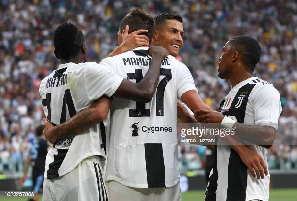 Mario Mandzukic of Juventus celebrates his goal with his teammates Blaise Matuidi and Cristiano Ronaldo during the Serie A match between Juventus and...