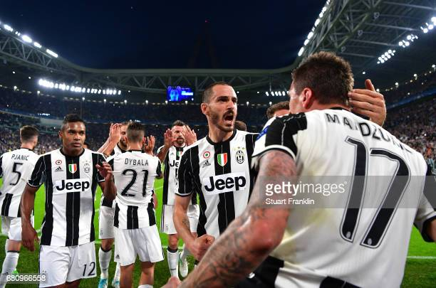Mario Mandzukic of Juventus celebrates scoring his sides first goal during the UEFA Champions League Semi Final second leg match between Juventus and...
