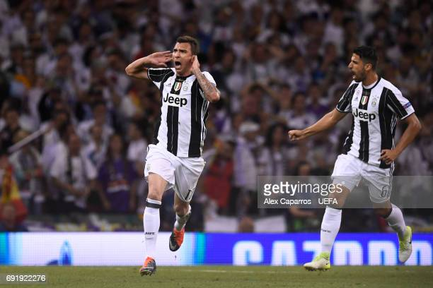 Mario Mandzukic of Juventus celebrates scoring his sides first goal during the UEFA Champions League Final between Juventus and Real Madrid at...