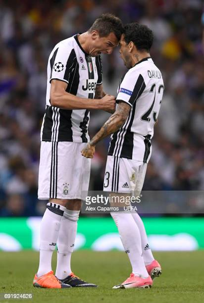 Mario Mandzukic of Juventus celebrates scoring his sides first goal with Dani Alves of Juventus during the UEFA Champions League Final between...