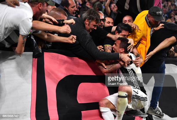 Mario Mandzukic of Juventus celebrates with fans after scoring his sides first goal during the UEFA Champions League Semi Final second leg match...