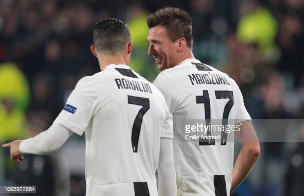 Mario Mandzukic of Juventus celebrates with his teammate Cristiano Ronaldo after scoring the opening goal during the Group H match of the UEFA...