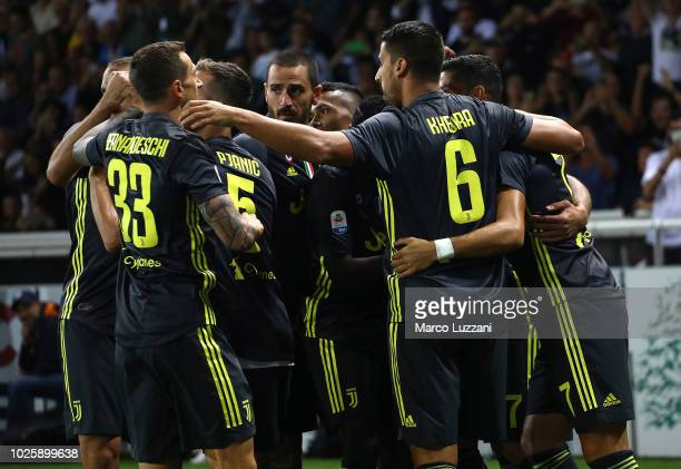 Mario Mandzukic of Juventus celebrates with his teammates after scoring the opening goal during the serie A match between Parma Calcio and Juventus...