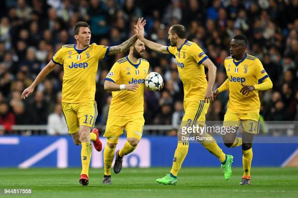 Mario Mandzukic of Juventus celebrates with teammate Giorgio Chiellini after scoring his sides first goal during the UEFA Champions League Quarter...