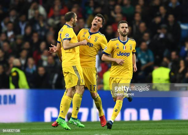 Mario Mandzukic of Juventus celebrates with teammate Giorgio Chiellini after scoring his sides second goal during the UEFA Champions League Quarter...