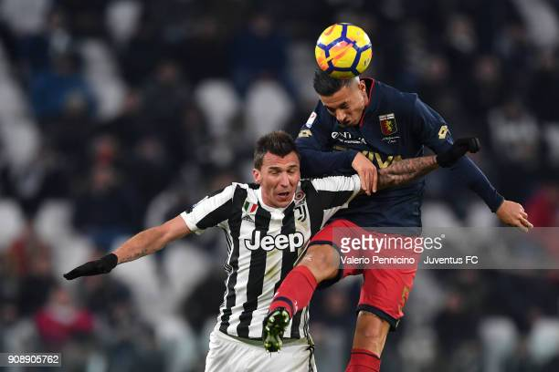 Mario Mandzukic of Juventus clashes with Armando Izzo of Genoa CFC during the Serie A match between Juventus and Genoa CFC on January 22 2018 in...