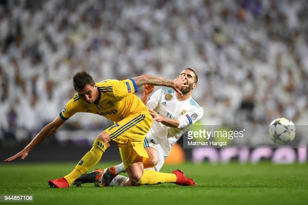 Mario Mandzukic of Juventus clashes with Daniel Carvajal of Real Madrid during the UEFA Champions League Quarter Final Second Leg match between Real...
