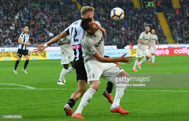 Mario Mandzukic of Juventus competes for the ball with Antonin Barak of Udinese Calcio during the Serie A match between Udinese and Juventus at...