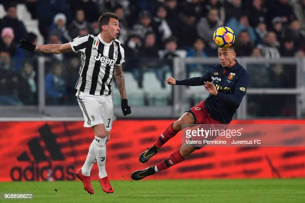 Mario Mandzukic of Juventus competes for the ball with Armando Izzo of Genoa CFC during the Serie A match between Juventus and Genoa CFC on January...