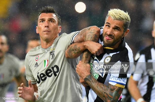 Mario Mandzukic of Juventus competes Valon Behrami of Udinese Calcio during the Serie A match between Udinese and Juventus at Stadio Friuli on...