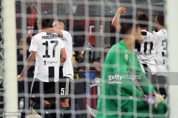 Mario Mandzukic of Juventus FC celebrates after scoring the his goal during the serie A match between AC Milan and Juventus FC at Stadio Giuseppe...